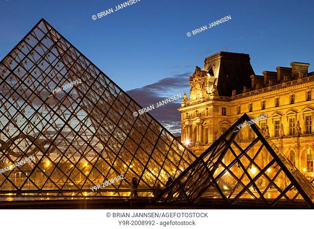 Courtyard of Musee du Louvre at twilight, Paris France