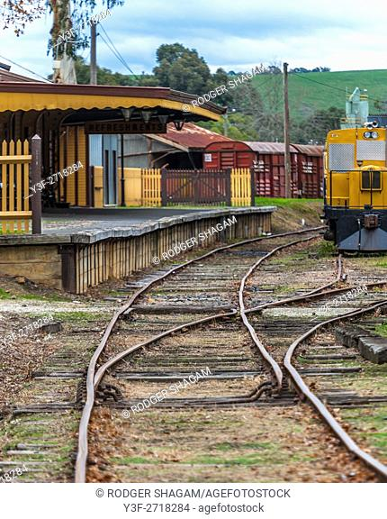 Old railway station and train tracks. Healesville station, in the Yarra Valley, Victoria, Australia