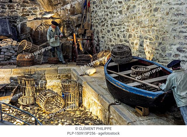 Diorama with fishermen working on harbour quay in the Port Musée, boat museum at Douarnenez, Finistère, Brittany, France