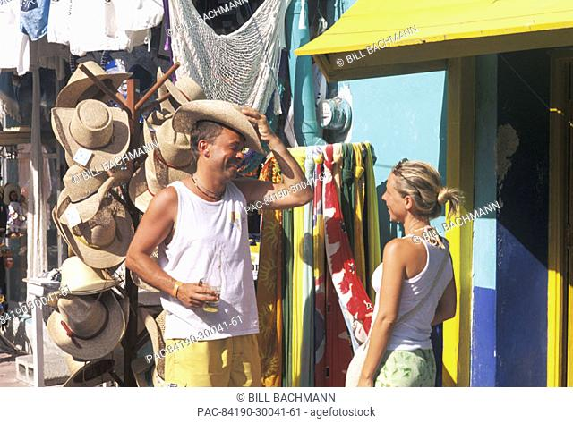Mexico, Isla Mujeres, Couple shopping, local storefronts