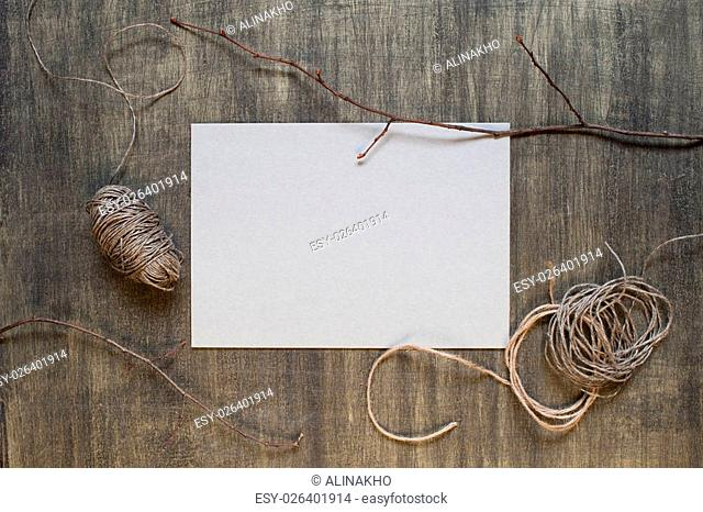 Blank sheet of paper and decoration on the wooden table