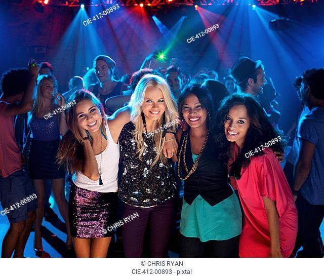 Portrait of smiling women on dance floor at nightclub