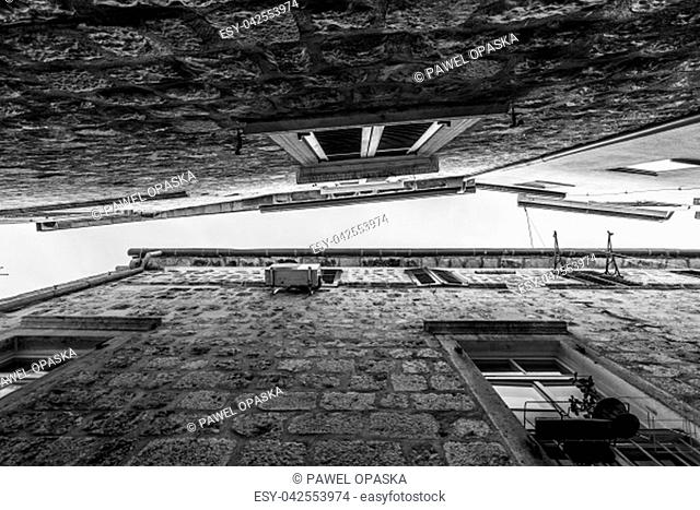 Black and white image of a upper part of historical buildings in the Kotor Old Town, Montenegro