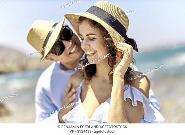 couple at beach, holidays, summer, love, flirt, happiness