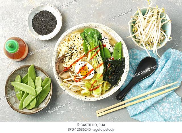 Ramen with chicken, egg, wakame, leek, peas and bok choy