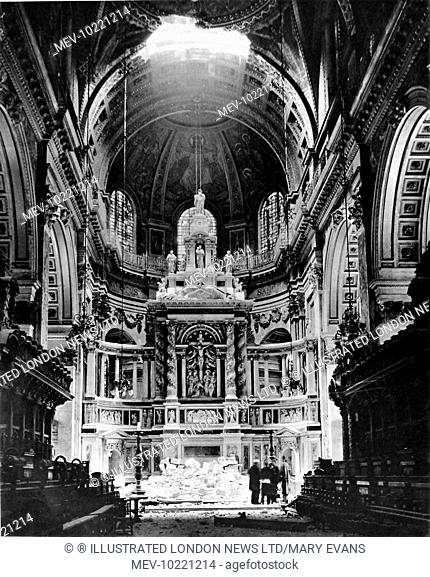 Photograph showing the High Altar of St. Paul's Cathedral, London, after a German bomb had exploded on the choir roof and destroyed a large section of roof