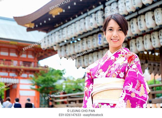 Asian woman wearing kimono at temple