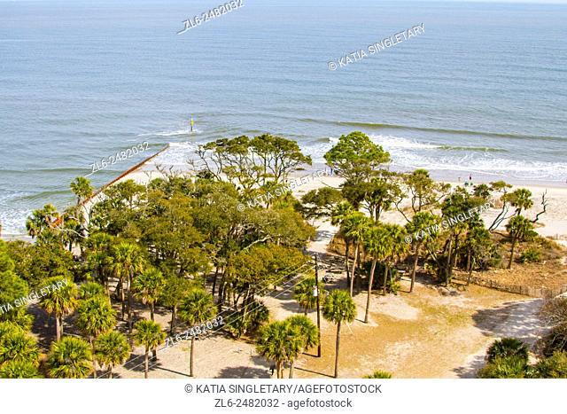 Beautiful view of the ocean, the beach and the forest from the top of the Lighthouse in South Carolina on the National park of Hunting Island on a sunny day
