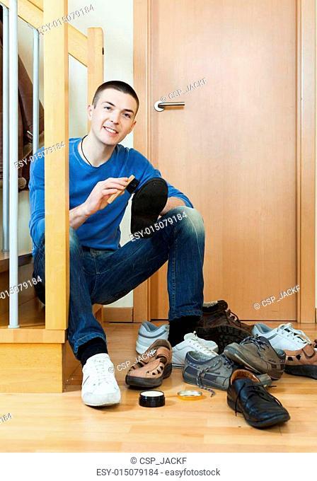 guy cleaning footwear