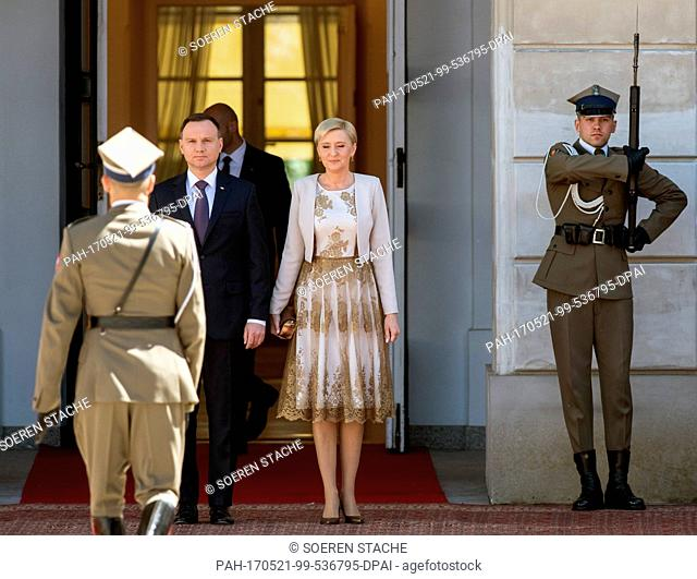 Polish President Andrzej Duda (2-L) and his wife Agata Kornhauser-Duda (C) await the arrival of German President Frank-Walter Steinmeier (not pictured) in front...