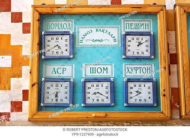 Uzbekistan - Bukhara - clocks showing prayer times outside the Bolo-Hauz Mosque