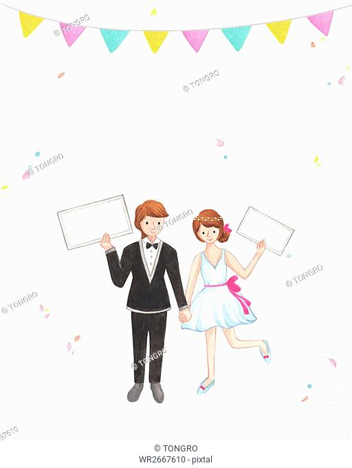 Smiling wedding.couple with cards posing