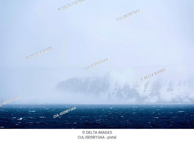 Arctic ocean and snowy coastal landscape, Wahlenberg fjord, Nordaustlandet, Svalbard, Norway