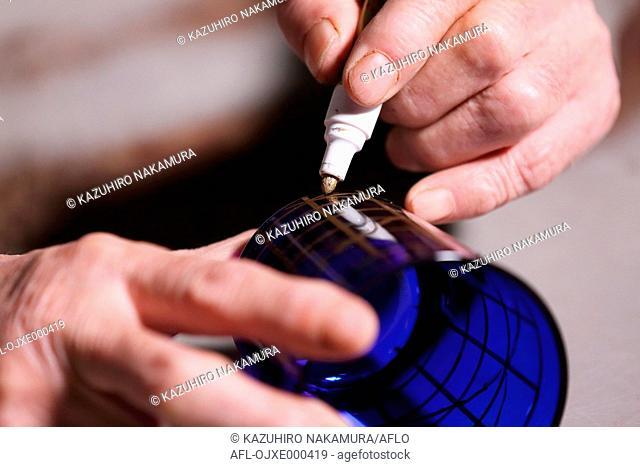 Edo Kiriko traditional Japanese glassware artisan working in the studio
