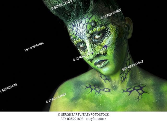 Fantastic Reptilian Girl. Creative Make up like Alien or Superhero Movie