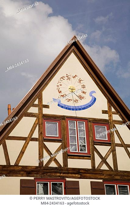 Close-up of a horoscope signs clock on a half-timbered building facade in the medieval town of Dinkelsbuhl, Germany