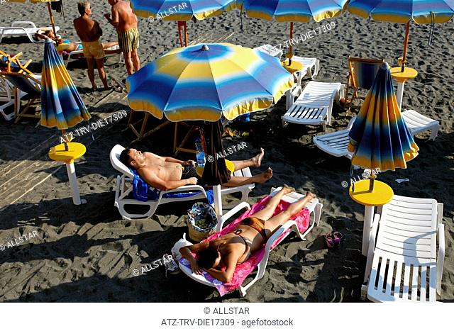 SUN BATHERS WITH BLUE & YELLOW PARASOLS; MAIORI, ITALY; 18/09/2011