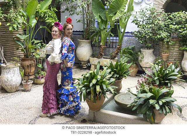 Women in traditional andalusian costume, Cordoba, Andalusia, Spain