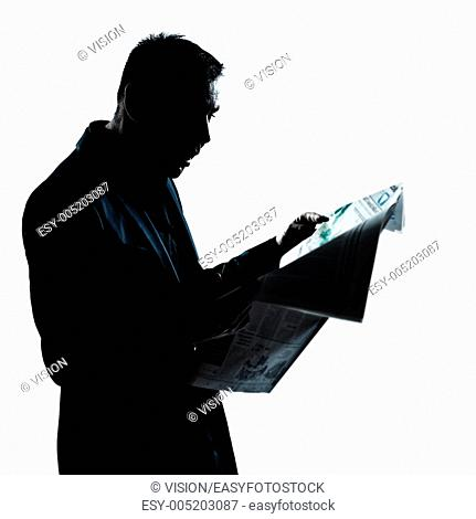 one caucasian man portrait silhouette reading newspaper surprised in studio isolated on white background