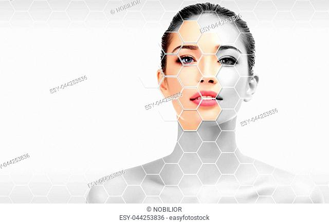 Pretty woman is touching her face, skin treatment concept