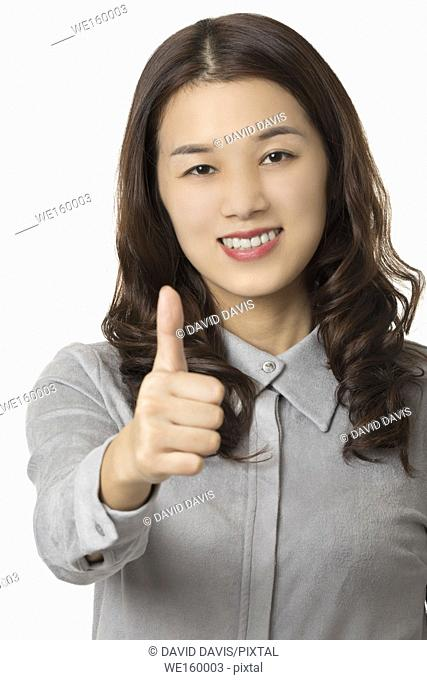 Portrait of a Beautiful Asian American woman displaying a bit of attitude isolated on a white background