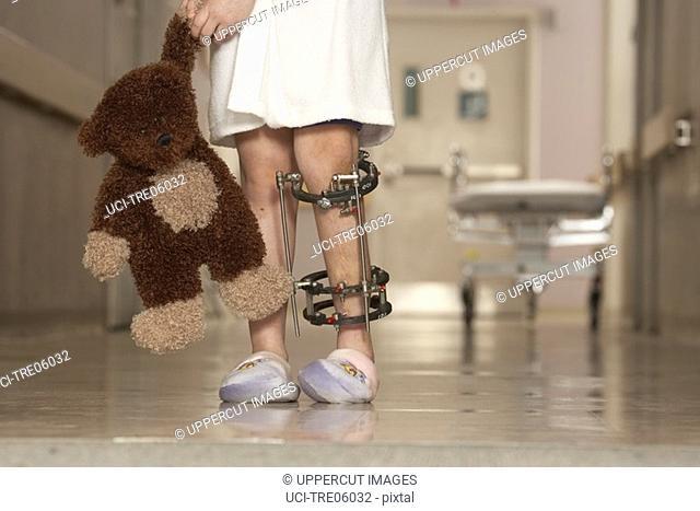 Low section of girl wearing leg brace