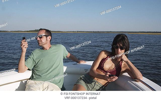 MS, Lockdown of a couple on a boat ignoring each other