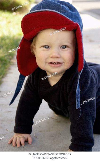 podrtrait of baby in red hood