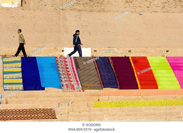 Saris drying on the ghats of Varanasi, Uttar Pradesh, India, Asia
