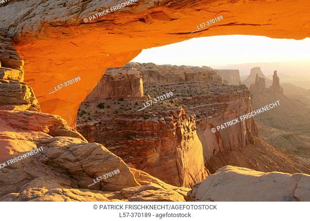 Washer Woman Arch seen through Mesa Arch at sunrise. Canyonlands National Park. Utah. USA