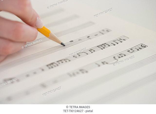Close up of woman writing music