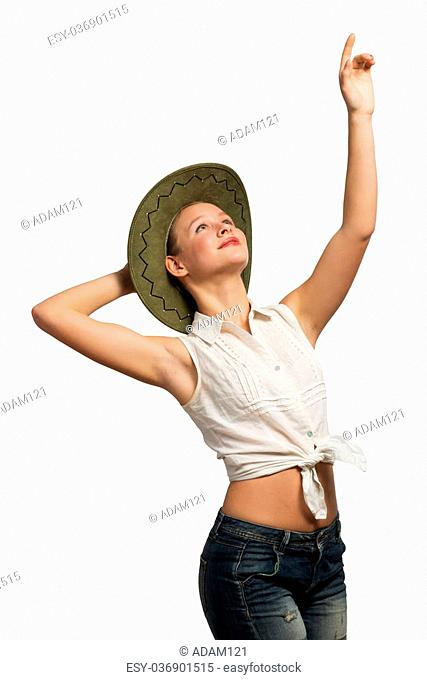 Pretty teenager girl in shots shirt and hat on white background