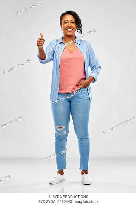 happy african american woman showing thumbs up