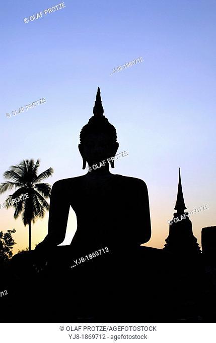 Silhouette of the Buddha at Wat Mahathat, Sukhothai, Thailand