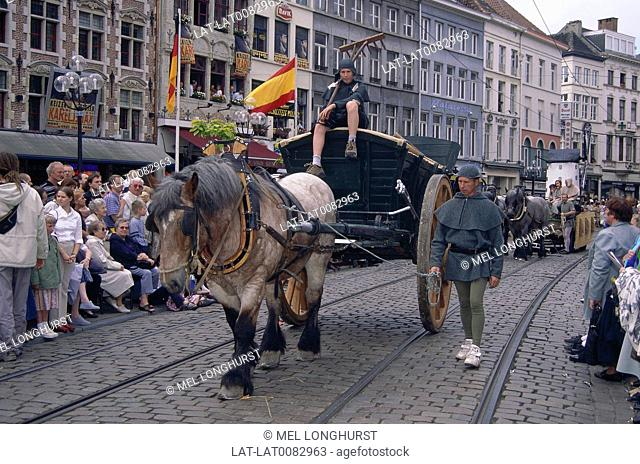 Kaiser Karel parade. Horse pulling huge farm cart. People in historical costume