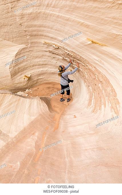 USA, Paria Canyon, Vermillion Cliffs, Page, tourist inside rock formation Nautilus