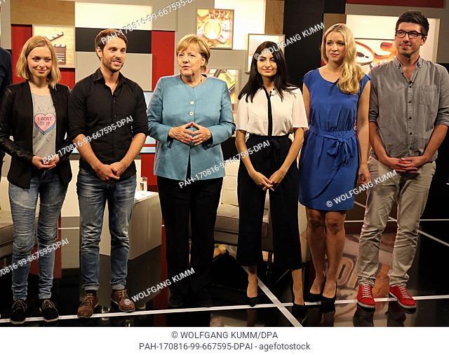German Chancellor Angela Merkel standing with Youtubers after she was interviewed in a livestream, in Berlin, Germany, 16 August 2017. L-r