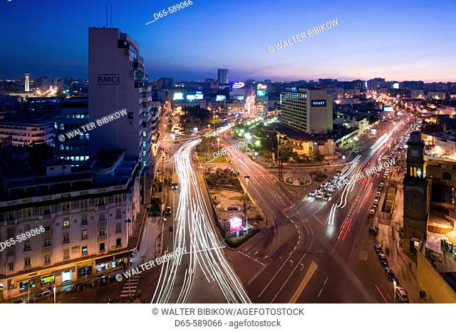 Morocco-Casablanca: Place des Nations Unies-Aerial View of Hyatt Hotel & Ancienne Medina Clock Tower / Evening