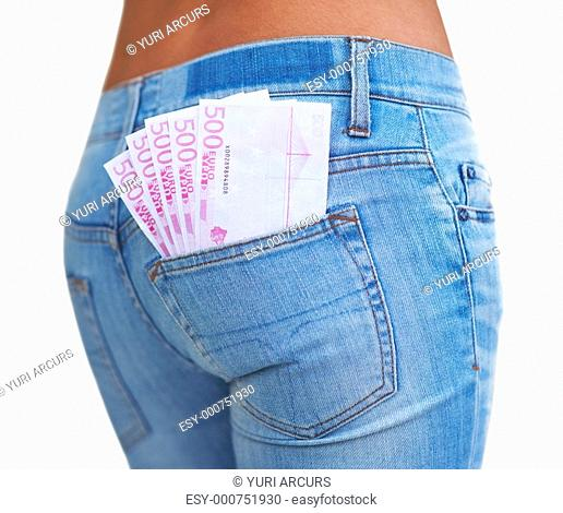 Closeup of woman's bottom with currency notes in the pocket on white background