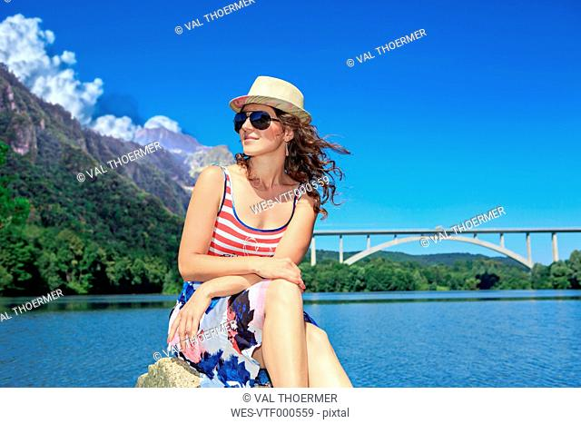 Madeira, portrait of a young woman sitting in front of lake