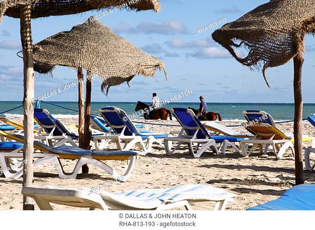 Beach scene on the Mediterranean coast in the tourist zone, Djerba Island, Tunisia, North Africa, Africa