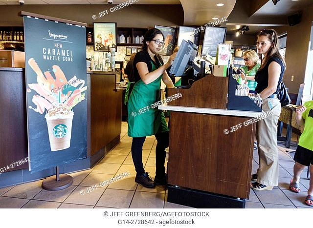Florida, Ellenton, Ellenton Premium Outlets mall, shopping center, Starbucks Coffee, coffeehouse, chain, salesclerk, cashier, job, ordering, paying, woman