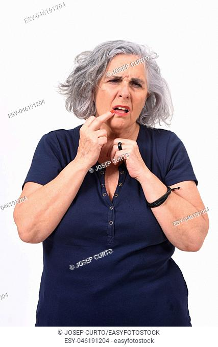 woman with pain on lip on white background