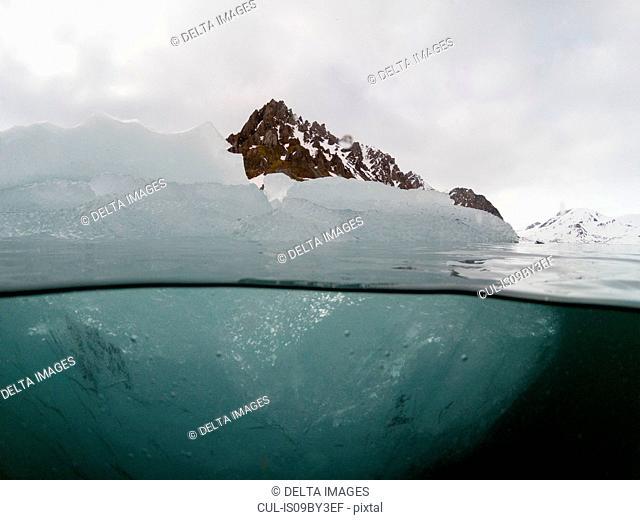 Over and underwater view of iceberg, Burgerbukta, Spitsbergen, Svalbard, Norway