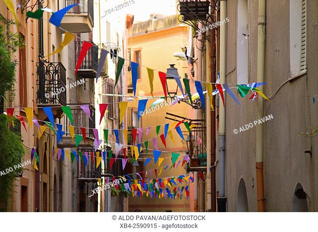 View of a city street with celebration flags, Bosa, Sardinia, Italy