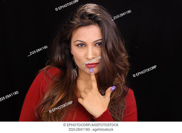 Close up portrait of attractive young woman thinking with finger on chin
