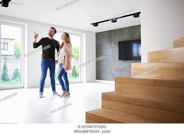 Couple looking around in empty flat