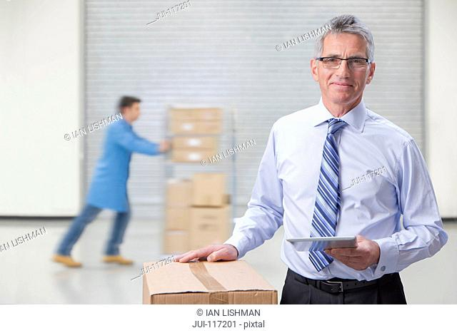 Portrait Of Businessman In Warehouse Dispatch Area