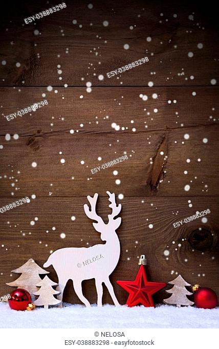 Vertical Christmas Card With White And Red Christmas Decoration On Snow And Snowflakes. Copy Space For Advertisement. Decoration Like Balls, Tree And Reindeer