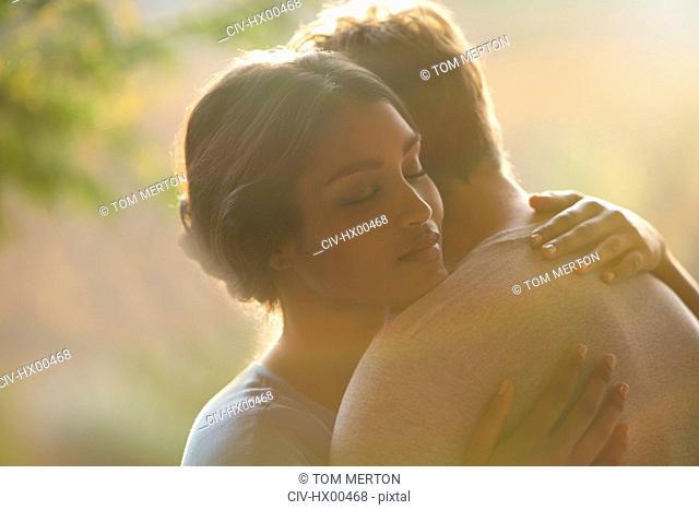 Close up serene couple hugging